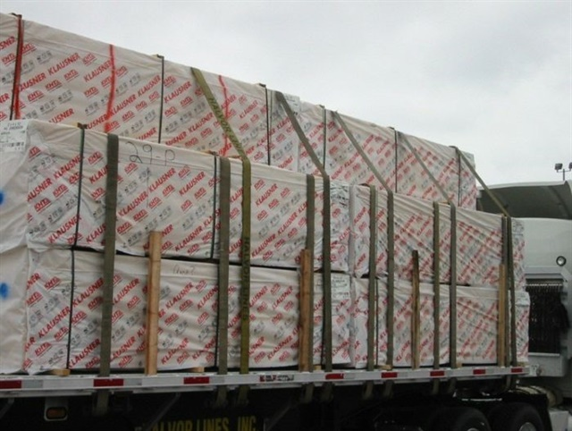 Belly strapping: The lower stack of this load was secured before the top stack was placed aboard and tied down. There are more than enough straps to satisfy safety and regulatory demands. Photos: Commercial Vehicle Safety Alliance