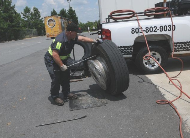Anybody can change a tire, but does your dealer make yard calls, and bring some inventory along so the necessary tires can be changed on site without delay? Photo: Jim Park