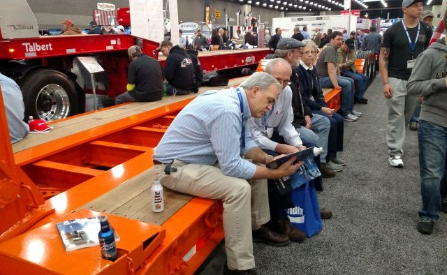 The Mid-America Trucking Show featured many trailer makers. Showgoers here make use of a lowbed trailer to take a break. Photos: Tom Berg