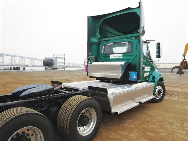 The third generation of TransPower's ElecTruck powertrain includes four large battery boxes hung from frame rails and another mounted behind the cab.