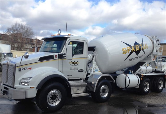 V2V communications systems will revolutionize how trucks work. In the near future, mixers like this one will upload data upon entering a jobsite and be automatically routed to where its load of cement is needed.