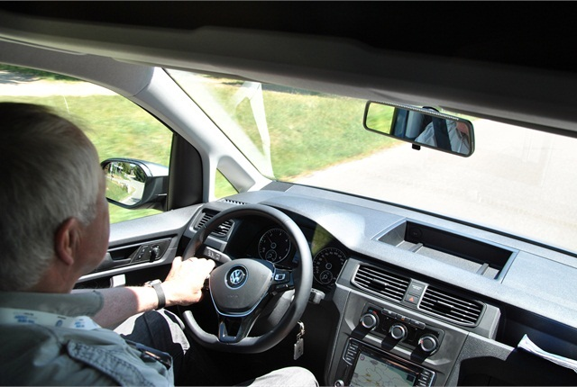 European correspondent Sven-Erik Lindstrand photographs himself sampling controls of a VW Caddy small van.