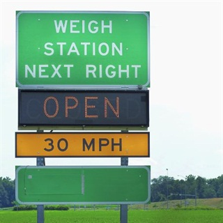 Bypassing weigh stations can save fleets time and fuel, which can cut costs immensely when multiplied over numerous vehicles. Photo: istockphoto.com