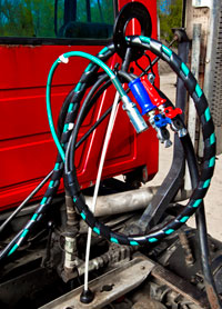 The MaxxDuty pogo stick eliminates the need for zip ties, allowing operators to run hydraulic and wrapped lines through the hoop.