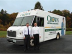 <p>Dave Hardy, Crown's fleet supervisor, (left) stands with Greg Franklin, a service manager, in front of a Crown Freightliner step van. Crown's fleet has reduced its daily idling time from 70 minutes per driver down to 7 minutes.</p>