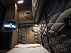 A golf tournament is displayed on the EpicVue flat-screen TV inside a truck's sleeper. The company offers its service based on three-year and five-year contracts. Photo via EpicVue