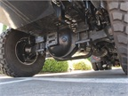 The driving steer axle gets the 122SD through spots that would stop a