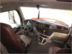 Simulated dark wood trim graces the dashboard and door panels, while