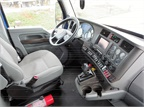 Dump truck s comfortable interior includes contoured driver s set and