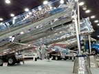 New Mac aluminum end-dumps gleam in the lights of the Mid-America Trucking Show earlier this year. Many lose their luster in day-to-day work, but are still are valued for their light weight and corrosion resistance. Photo: Tom Berg