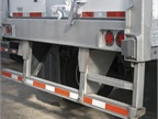 This step built into the rear impact guard of a Utility trailer adds a