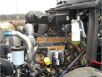 The Navistar-made 12.4-liter diesel is painted Cat yellow. It does not
