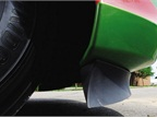 The flexible rubber air dam under the bumper smooths the air going
