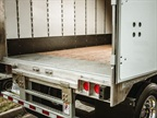 Most vans get swing doors, which are comparatively simple and, when locked shut, help stiffen the trailer's body structure. And rugged yet economical laminated hardwood floors go in 95% of dry-freight vans.
