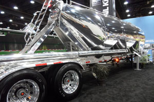 Lightweight corrosion-resistant aluminum continues as a leading material for components and complete trailers, like this Trail King pneumatic dry bulk tanker with a tare weight of 8,450 pounds, 500 less than usual.