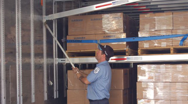 One worker can adjust Lift-A-Deck II's shoring beams to accommodate cargo below and support freight that will be placed on the beams. Integral securement straps keep freight from shifting and falling.