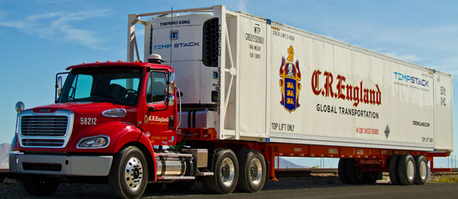 C.R. England's new containers go from China to the American Midwest to be outfitted with Thermo King reefer units. Drayage tractors are Freightliner M2-112s with DD13 engines.
