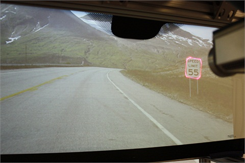 This prototype heads-up display (HUD) highlights road signage (image 1) and road curvature in poor visibility conditions (image 2).