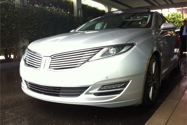The 2013 MKZ retains Lincoln's signature split-wing grille. This redesigned model, out next month, represents the new face of the brand.