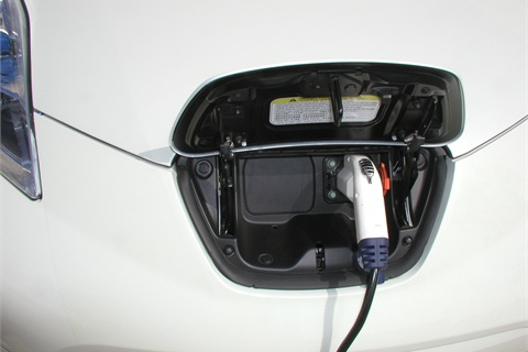 "The Leaf's onboard charger plugs into a regular 110/120V household outlet. This Level 1 ""trickle charge,"" however, will take close to 20 hours from a depleted battery to full charge. The Level 2 home charging dock, which works off of a 220/240v line, charges the car to 80 percent in about seven hours. Commercial quick-charge (480v) stations take less than 30 minutes, though very few are online and available."