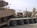 The Army Uses Serious Rigs to Haul Armored Vehicles