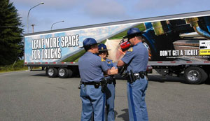 Washington State enforcement officers with a truck wrapped with the TACT safety message.