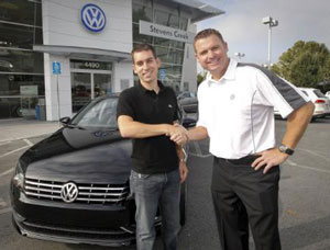 The first 2012 Passat owner, Matt Duchesne, receives his all-new clean-diesel-powered Volkswagen from Mike Gabbani, general sales manager at Stevens Creek Volkswagen, in San Jose, Calif.