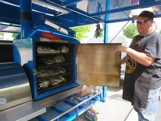 Robert Smith from Pitt s and Spitt s shows off BBQ brisket waiting for