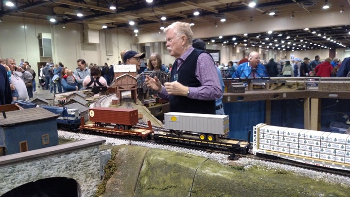 S-scale modeler Larry Robertson chats with a visitor as his freight