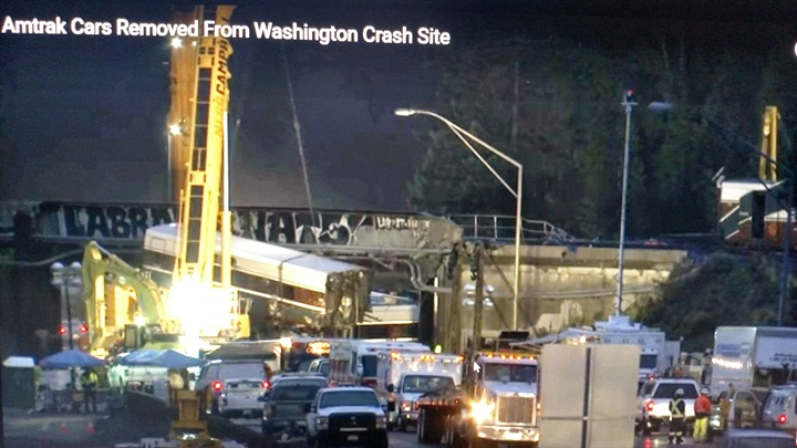 Working overnight, crews used tall cranes to loaad wreckage from the
