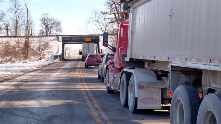On SR 42 just northeast of Delaware, Ohio, a trucker has stopped to