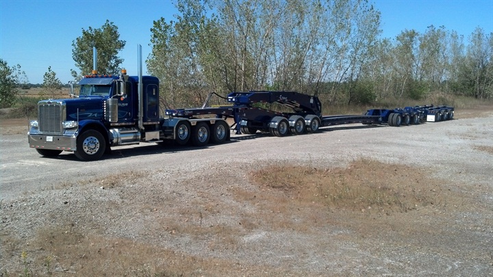 Trailer includes a 3-axle  jeep  dolly, 3-axle lowboy and 3 flip-down