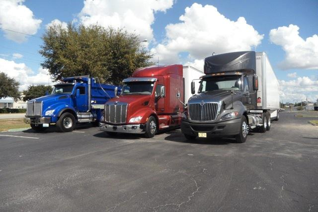 Three heavy duty entries rest at day s end. From left, Kenworth T880