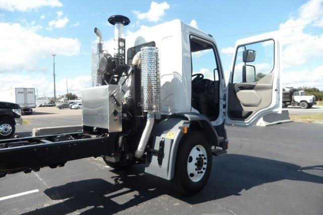 Peterbilt 220, built for street sweeping, has right-hand drive, while