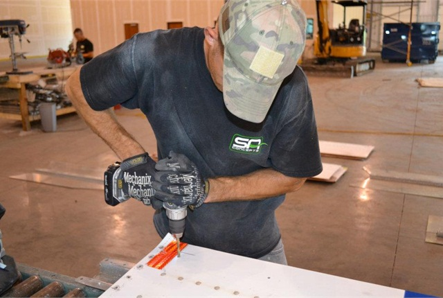 Military vets build and install the Aerosmart aluminum skirts at SA Concepts' plant in Springdale, Ark.