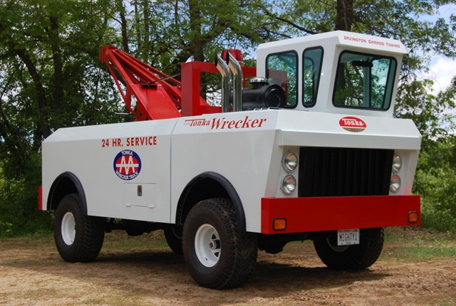 This unusual vehicle is a life-size replica of a Tonka tow truck.