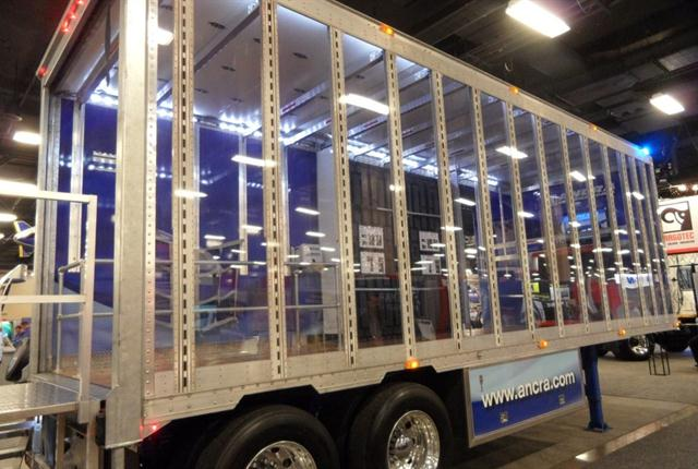 Lexan panels in the right-side wall of Ancra's display trailer lets truck show viewers see what's displayed inside. But you'll want to go in there yourself.