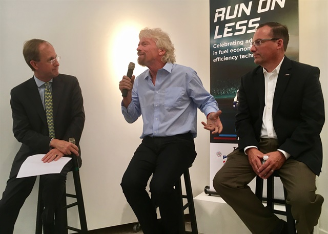 """Richard Branson (center) expounds on how trucking's mpg efforts are a """"ray of hope"""" in the global campaign to save fuel and protect the planet from climate change. Looking on (right) is NACFE's Mike Roeth. Photo: David Cullen"""