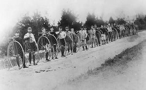 "Touring cyclists with their high-wheeled conveyances, called ""ordinaries,"" near Readville, Massachusetts, in September 1879. At far left is Charles Pratt, first president of the League of American Wheelmen."