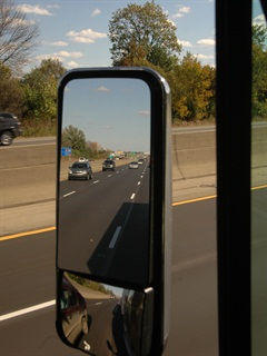 Even glancing through a mirror can be distracting, but drivers have done it safely for decades. Photo: Jim Park