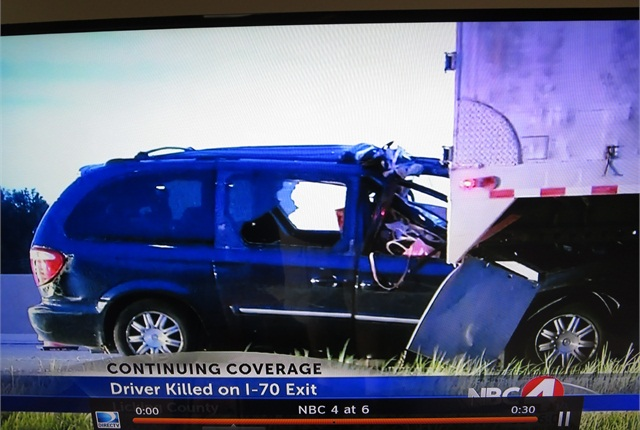 In spite of the underride, the van's driver door opened and the motorist removed that way. Photo: Tom Berg, image via WCMH-TV