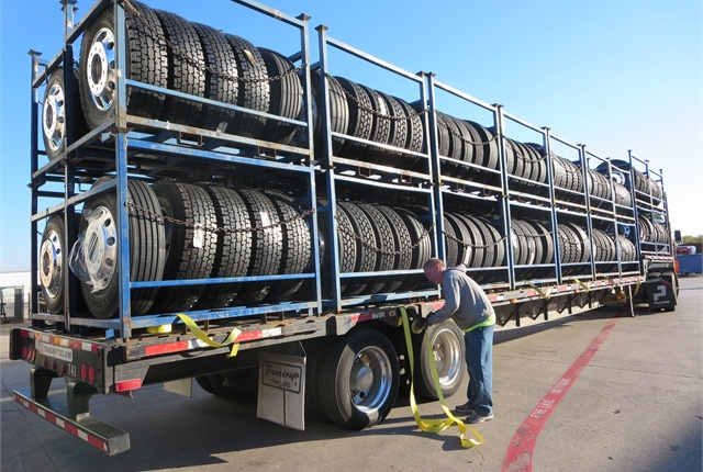 If this rig suffers a flat tire, its driver has plenty of spares. Naw -- he's delivering the load to Peterbilt's plant in Denton, Tex.