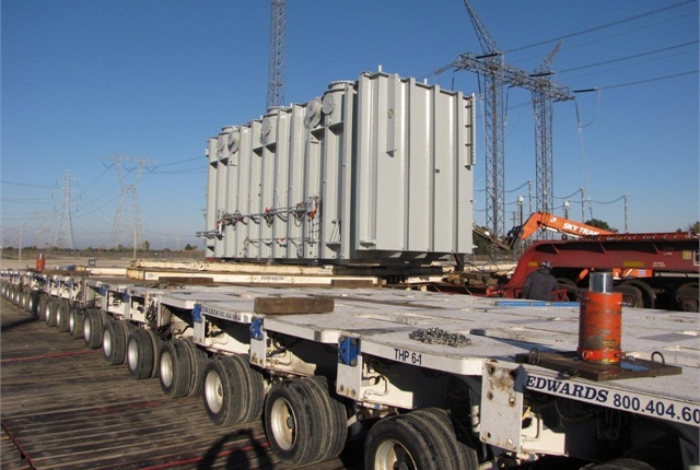 With 21 axle-lines and 336 wheels, the transporter easily shoulders the heavy transformer. Two days later it moved 17 miles to where it'll work, at a new substation near Sunbury, Ohio.