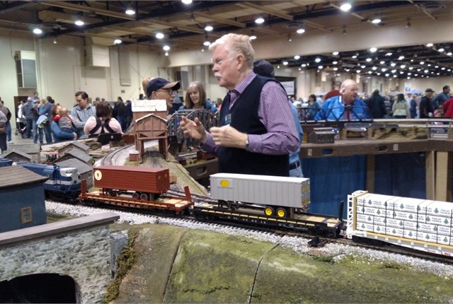 S-scale modeler Larry Robertson chats with a visitor as his freight train pauses on the tracks. Note the trailer-on-flatcar loads, an activity of progressive railroads starting in the 1950s. Photos: Tom Berg