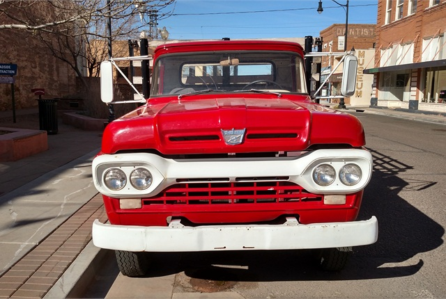 1960 or so F-500 is clean and at least cosmetically restored. Nose emblem has a lightening bolt, indicating there's an inline 6 under the hood.