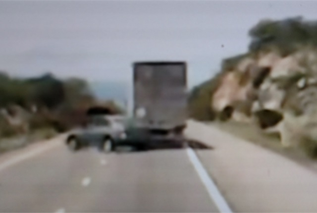 Out-of-control car has bumped the semi and now veers to the left and will mangle itself on the rock wall, then.... Photo: Tom Berg from ADPS video.