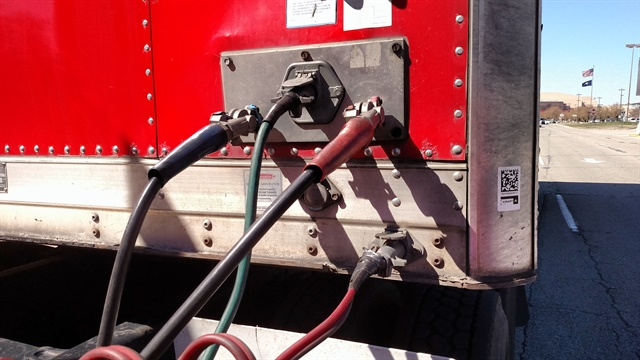 Second electrical cable (lower right) on this beverage trailer carries power to charge its liftgate batteries. It coud also carry signals to a high-performance braking system.