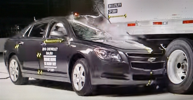 Exhisting rear impact guards were much improved over old bumpers, but didn't protect against offset crashes, as shown in this IIHS test.  Photo: Insurance Institute for Highway Safety