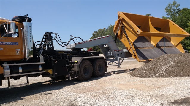 Off-road side-dump trailer offloads more than 50 cubic yards of gravel. Rigs like this are operating at mines in Canada and Australia, Western Star says.