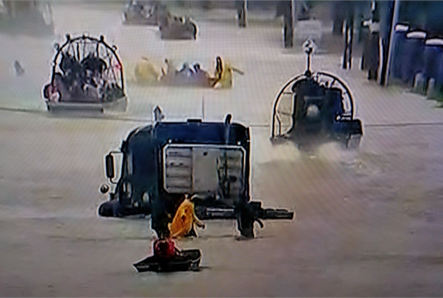 Most civilian trucks, including this tractor that seems to be hitched to a drop-deck trailer, could not cope with Harvey's deep waters. As winds subsided, air boats joined outboard-motor-powered craft and helicopters in rescue efforts. Image: Screen capture, ABC News
